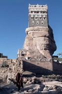 a tall rock building